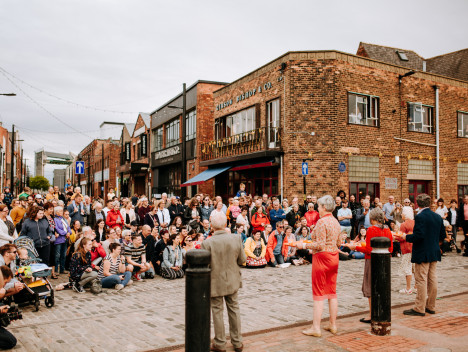 A large audience on Humber Street watching performance from Adhok in The Great Escape.